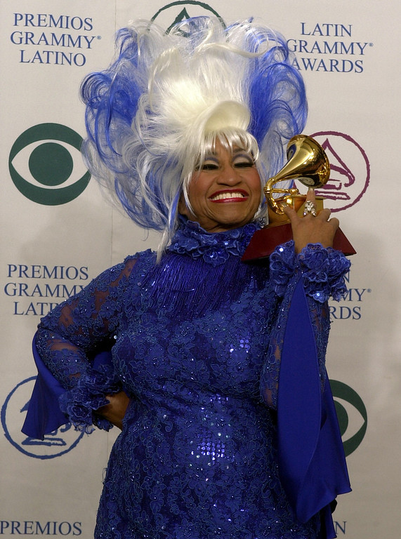 ". Cuba\'s Celia Cruz holds up the award she won for best salsa album for ""La Negra Tiene Tumbao\"" at the 3rd annual Latin Grammy Awards Wednesday, Sept. 18, 2002, in the Hollywood district of Los Angeles. (AP Photo/Reed Saxon)"