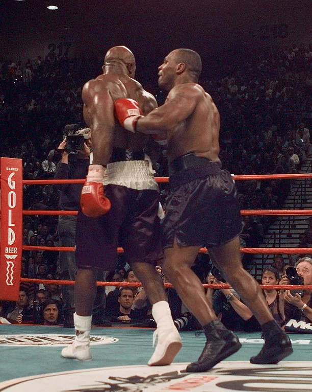 . Mike Tyson shoves Evander Holyfield after Tyson bit Holyfield\'s ear in the third round of their WBA Heavyweight match Saturday, June 28, 1997, at the MGM Grand in Las Vegas.  The fight was stopped and Holyfield retained his title. (AP Photo/Mark J. Terrill)