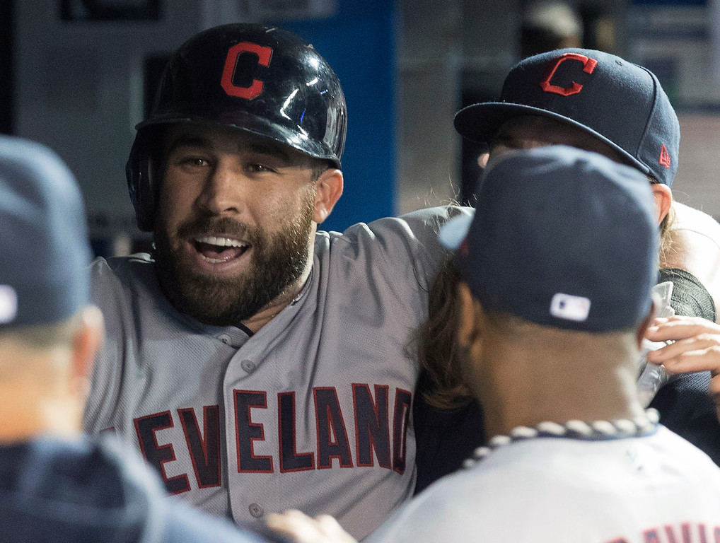. Cleveland Indians\' Jason Kipnis is congratulated by teammates after his three-run home run against the Toronto Blue Jays during the ninth inning of a baseball game Thursday, Sept. 6, 2018, in Toronto. (Fred Thornhill/The Canadian Press via AP)
