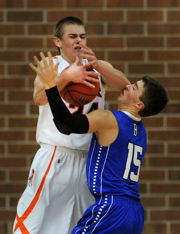 . Rangers forward Justin Smith (24) battled for the ball with Broomfield guard Evan Kihn (15) in the second half. The Lewis-Palmer High School boy\'s basketball team defeated Broomfield 75-53 Friday night, December 7, 2012.  Karl Gehring/The Denver Post