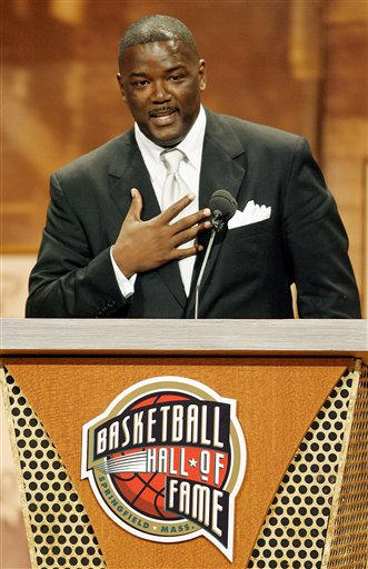 Description of . Former Detroit Pistons player and current president of basketball operations for the Pistons, Joe Dumars, remarks about the meaning of his enshrinement into the Naismith Memorial Basketball Hall of Fame as part of the class of 2006 in Springfield, Mass., Friday night, Sept. 8, 2006. (AP Photo/Stephan Savoia)