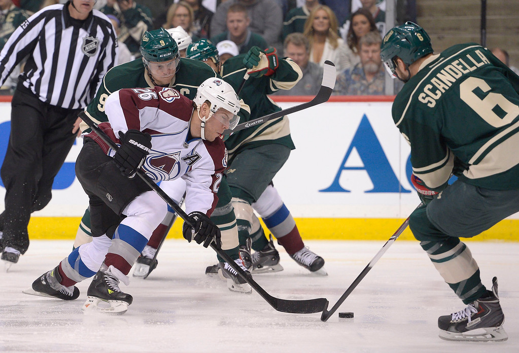 . Colorado Avalanche center Paul Stastny (26) skates after the puck with Minnesota Wild center Mikko Koivu (9) and Minnesota Wild defenseman Marco Scandella (6) in on defense during the first period April 21, 2014 during round 1 game three of the Stanley Cup Playoffs at Xcel Energy Center. (Photo by John Leyba/The Denver Post)