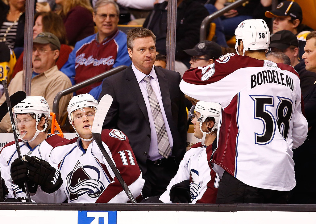 . Head coach Patrick Roy of the Colorado Avalanche talks to Patrick Bordeleau #58 of the Colorado Avalanche in the second period against the Boston Bruins during the game on October 10, 2013 at TD Garden in Boston, Massachusetts. (Photo by Jared Wickerham/Getty Images)