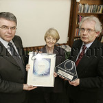 The Principle of St Josephs High school Newry Mr McGovern and Mr Murtagh recieve  the Investor in people award from Imelda McDaid RTU. 06W10N8