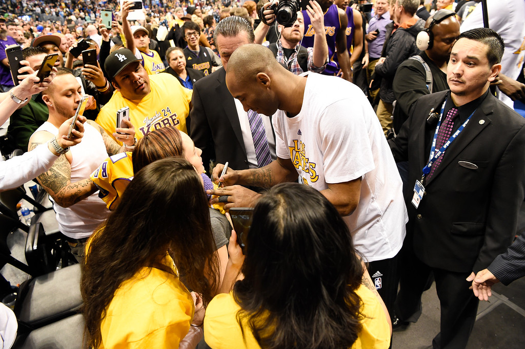 . DENVER, CO - MARCH 02: Los Angeles Lakers forward Kobe Bryant (24) signs autographs after leaving the court after the Los Angeles Lakers loss to the Denver Nuggets 117-107 March 2, 2016 at Pepsi Center. Kobe Bryant retires at the end of the season. (Photo By John Leyba/The Denver Post)