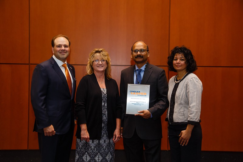 Thomas Roberts, Jr., MD, Chair of the Conquer Cancer Foundation, presenting the Clinical Trials Participation Awards to Joliet Oncology Hematology Associates, Ltd. represented by Kulumani Sivarajan, MD, during Clinical Trials Participation Awards