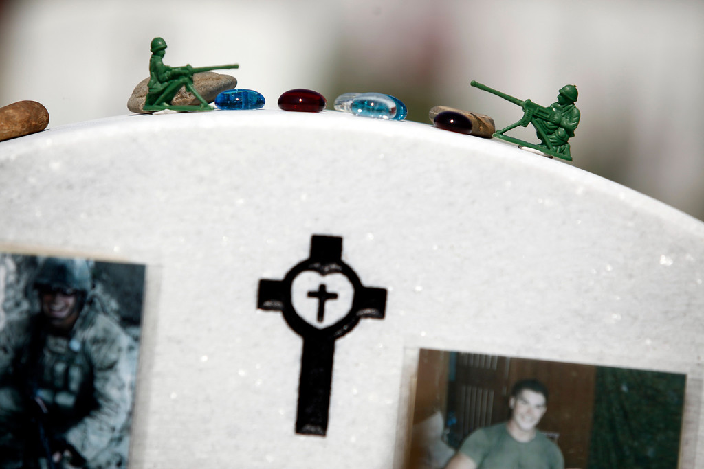 . Plastic army men left on the gravestone of Marine Cpl. Kyle R. Schneider, who died in Afghanistan on June 30, 2011, in section 60 of Arlington National Cemetery on Memorial Day in Arlington, Va., May 28, 2012.  (Luke Sharrett/The New York Times)