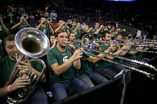 . The Michigan State pep band plays during the first half of an NCAA tournament college basketball game against Virginia in the Round of 32 in Charlotte, N.C., Saturday, March 21, 2015. (AP Photo/Nell Redmond)
