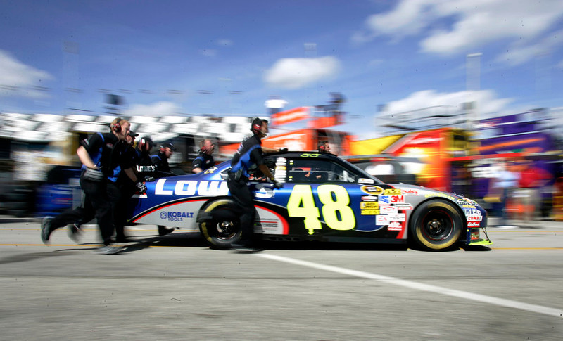 . The crew of NASCAR driver Jimmie Johnson pushes his car through the garage area during practice for the Daytona 500 auto race at Daytona International Speedway in Daytona Beach, Fla., Wednesday, Feb. 11, 2009.(AP Photo/Reinhold Matay)