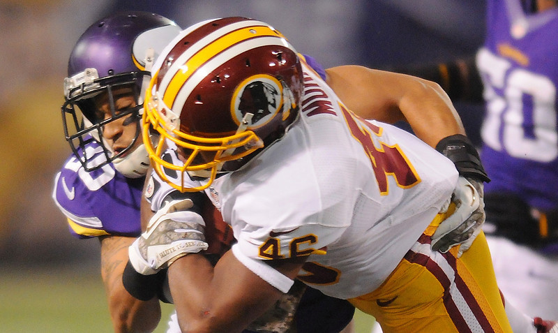 . Minnesota safety Robert Blanton tackles Washington running back Alfred Morris. (Pioneer Press: John Autey)