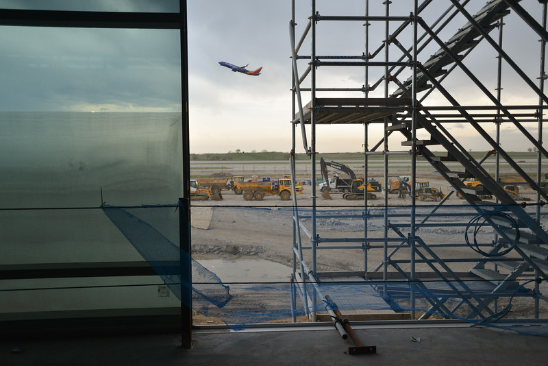 A Southwest Airlines passenger jet takes off from KCI on Tuesday afternoon as seen from what will be part of concourse B at the new terminal. Part of the glass enclosure at left is an example of much of the construction at the facility where natural light will stream in with abundance.