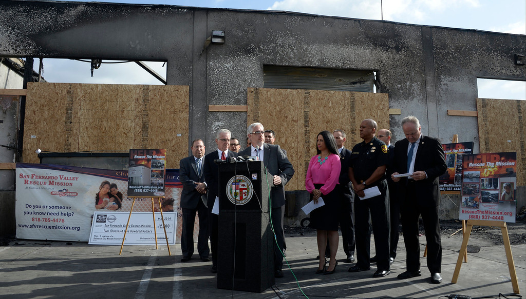 . Wade Trimmer, executive director of the San Fernando Valley Rescue Mission, speaks at a May 8, 2014 press conference, flanked by Los Angeles city officials, after a fire destroyed the mission\'s North Hollywood emergency shelter, vehicle fleet, clothing warehouse and food pantry. (Photo by Gene Blevins/Los Angeles Daily News)