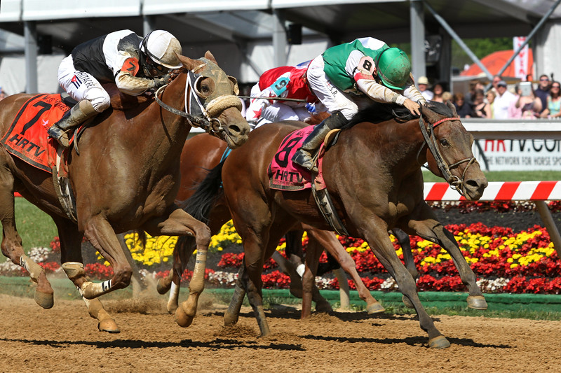 I'm Mom's Favorite (Indian Charlie) and jockey Sheldon Russell win the Ms. Preakness Pink Warrior Stakes at Pimlico Racecourse 5/17/13. Trainer: Tony Dutrow. Owner: CJZ Racing Stable
