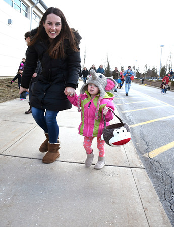 3/24/2018 Mike Orazzi | Staff Laureen Gruner and her daughter Peyton,2, search for eggs while at the annual Terryville Lions Club Easter Egg Hunt held at Terryville High School Saturday.