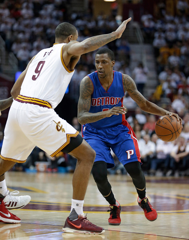 . Detroit Pistons\' Kentavious Caldwell-Pope (5) drives past Cleveland Cavaliers\' Channing Frye (9) in the second half in Game 2 of a first-round NBA basketball playoff series, Wednesday, April 20, 2016, in Cleveland. (AP Photo/Tony Dejak)