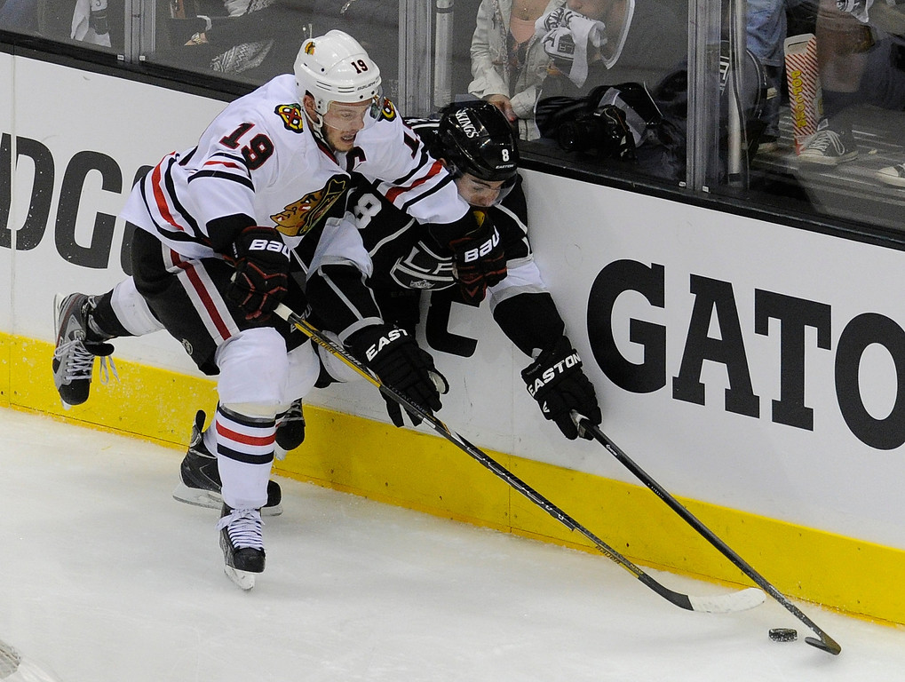 . Kings#8 Drew Doughty and Blackhawks#19 Jonathan Toews battle on the boards for control of the puck in the 3rd period. The Kings defeated the Chicago Blackhawks in the 3-1 in the 3rd game of the Western Conference Finals. Los Angeles, CA 6/4/2013(John McCoy/LA Daily News4