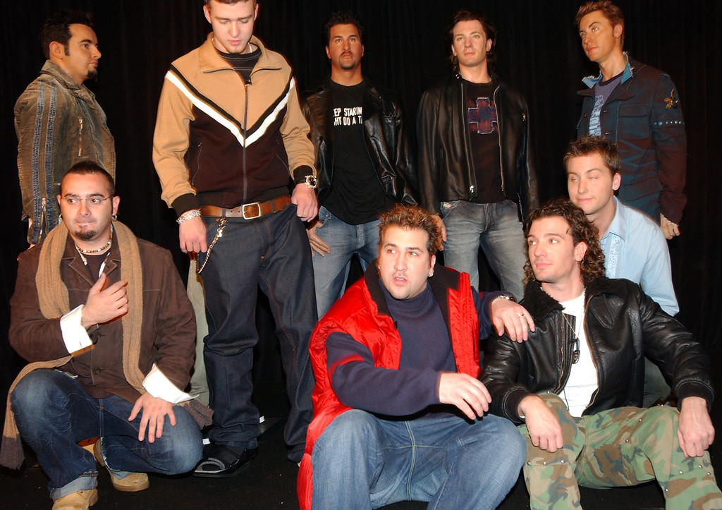 . The five members of N*SYNC front, from left, Chris Kirkpatrick, Justin Timberlake, Joey Fatone, JC Chasez and Lance Bass  pose fo in front of their wax figures. The unveiling took place during a special celebrity event at Madame Tussaud\'s New York wax museum in New York Wednesday, Dec. 11, 2002.  (AP Photo/Scout Tufankjian)
