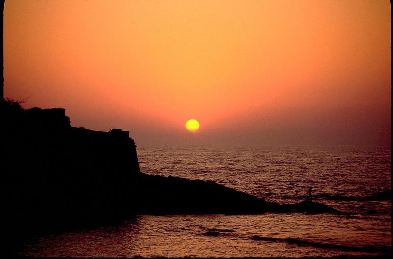 lone fisherman at sunset