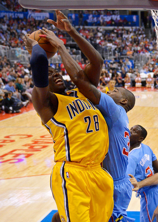 . Indiana Pacers center Ian Mahinmi, left, of France, has his shot blocked by Los Angeles Clippers forward Antawn Jamison during the second half of an NBA basketball game, Sunday, Dec. 1, 2013, in Los Angeles. (AP Photo/Mark J. Terrill)