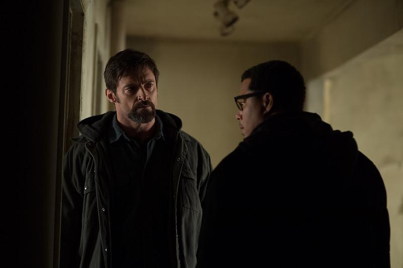 . Hugh Jackman as Keller Dover and Terrence Howard as Franklion Birch in \'Prisoners.\' (Wilson Webb/Warner Bros. Pictures)