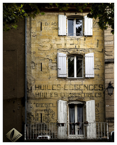 This must have been a Shell Oil station in Uzes at some point or perhaps just a type of billboard.  Now appears to be a home with a newstand next door (Presse),