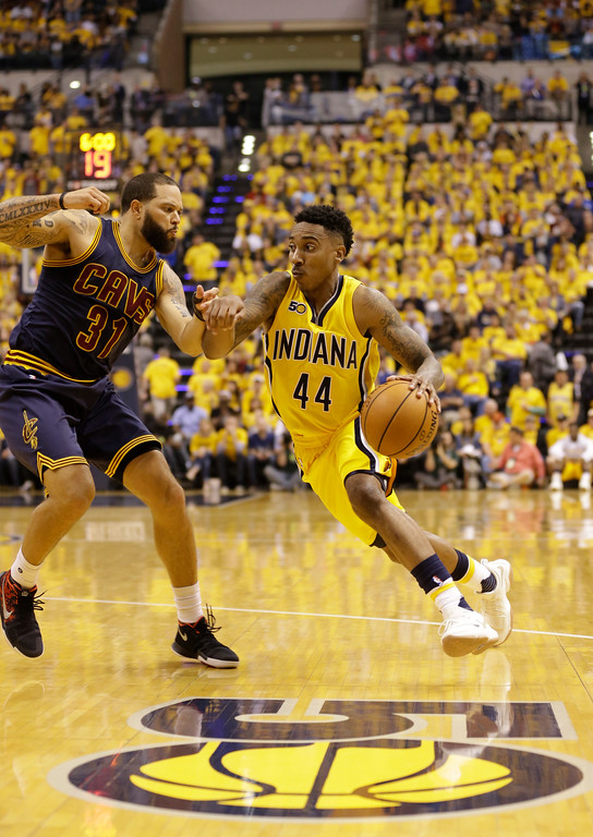 . Indiana Pacers guard Jeff Teague (44) drive son Cleveland Cavaliers guard Deron Williams (31) in the second half of Game 3 of a first-round NBA basketball playoff series, Thursday, April 20, 2017, in Indianapolis. The Cavaliers defeated the Pacers 119-114. (AP Photo/Michael Conroy)