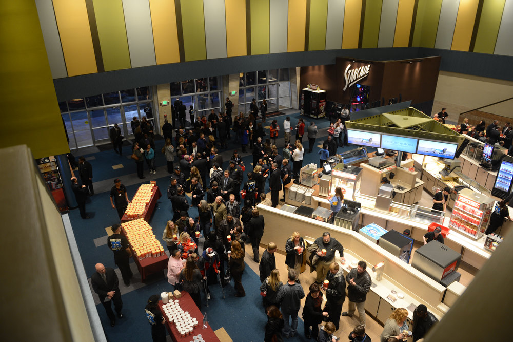 Description of . AURORA, CO. - JANUARY 17:  The lobby fills with guests for the reopening and remembrance of the Century Aurora Theater. James Holmes is accused of killing 12 people and wounding 70 others on July 20, 2012 in theater 9. (Photo By RJ Sangosti / The Denver Post)