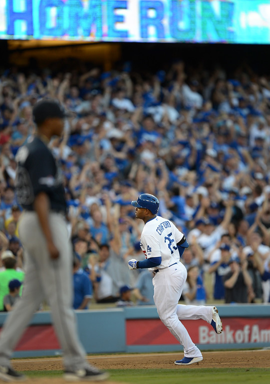 . Los Angeles Dodgers\' Carl Crawford brings in a 3-run home in the second inning during game 3 of the NLDS at Dodger Stadium Sunday, October 6, 2013. (Photo by Hans Gutknecht/Los Angeles Daily News)