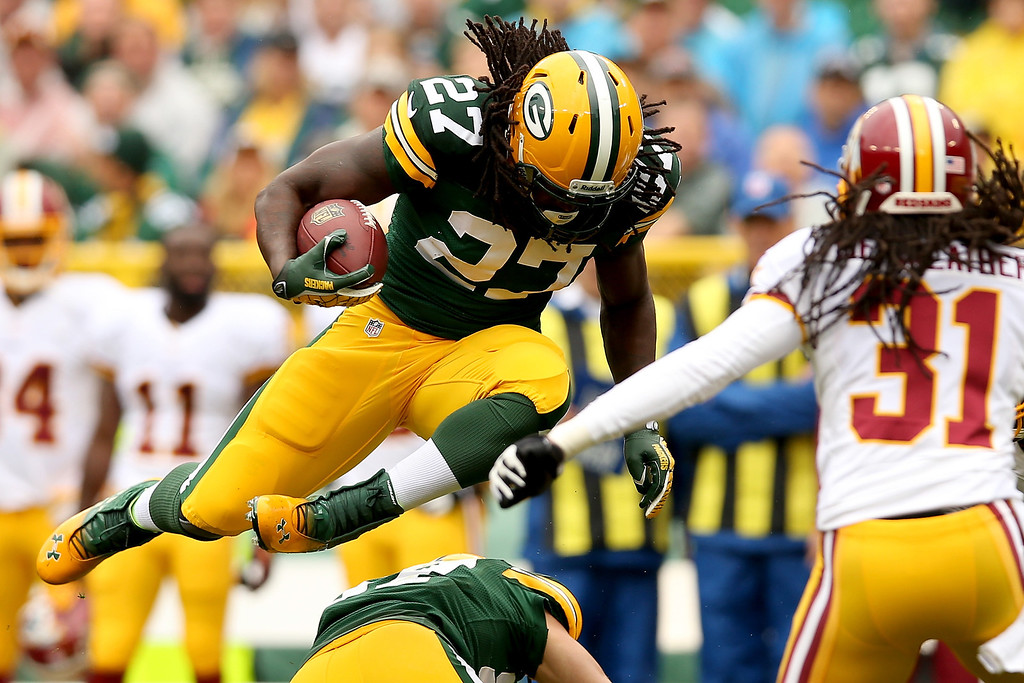 . Eddie Lacy #27 of the Green Bay Packers carries the ball against the the Washington Redskins at Lambeau Field on September 15, 2013 in Green Bay, Wisconsin.  (Photo by Matthew Stockman/Getty Images)