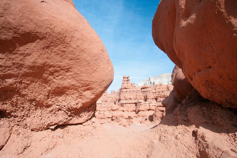 Boulders frame Hoodos in Goblin Valley State Park near Hanksvillle and Green River, Utah.