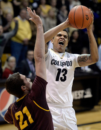 . Colorado\'s Dustin Thomas takes a shot over Eric Jacobsen during a game against Arizona State on Wednesday, Feb. 19, in Broomfield, Colorado.  Jeremy Papasso/Boulder Daily Camera