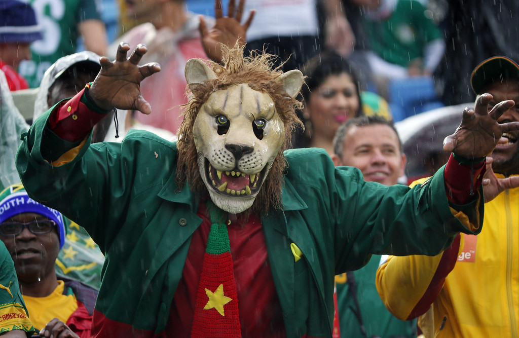 . A Cameroon supporter wearing a mask gestures before the start of the group A World Cup soccer match between Mexico and Cameroon in the Arena das Dunas in Natal, Brazil, Friday, June 13, 2014.   (AP Photo/Sergei Grits)