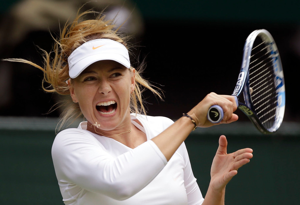 . Maria Sharapova of Russia returns the ball to Kristina Mladenovic of France during their Women\'s first round singles match at the All England Lawn Tennis Championships in Wimbledon, London, Monday, June 24, 2013.  (AP Photo/Anja Niedringhaus)