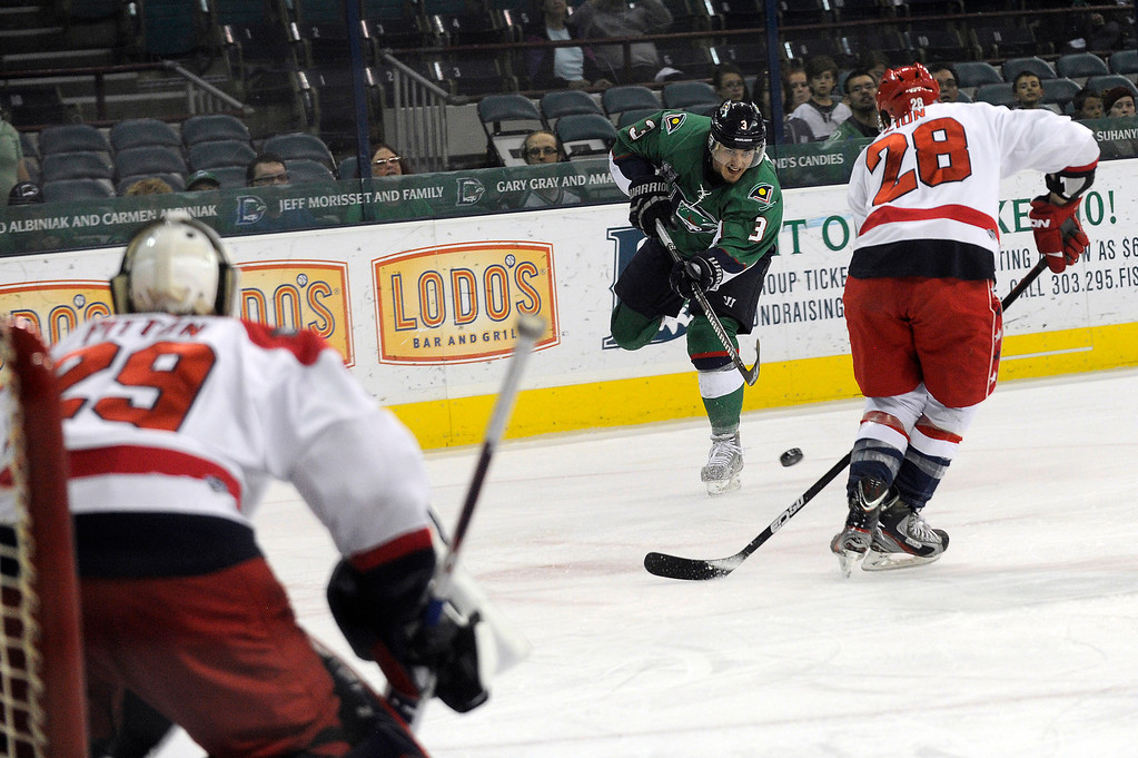 . DENVER, CO - MAY 2: Lee Moffie (3) of the Denver Cutthroats takes a shot on goal as Jonathon Zion (28) of the Allen Americans attempts to block the shot during the first period of game 1 of the Ray Miron Presidents Cup Finals at the Denver Coliseum in Denver, Colorado on May 2, 2014. (Photo by Seth McConnell/The Denver Post)
