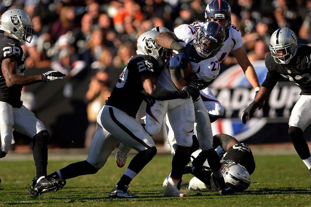 . Running back Knowshon Moreno (27) of the Denver Broncos making yards through a big hole vs the Oakland Raiders at O.co Coliseum December 29, 2013 Oakland, Calif. (Photo By Joe Amon/The Denver Post)