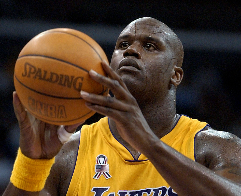 . Los Angeles Lakers\' Shaquille O\'Neal readies to shoot a free throw against the Seattle SuperSonics during the fourth quarter Monday, April 15, 2002, at the Staples Center in Los Angeles. O\'Neal made 9 of 11 free throws and scored a game-high 41 points in their 111-104 win. (AP Photo/Kevork Djansezian)