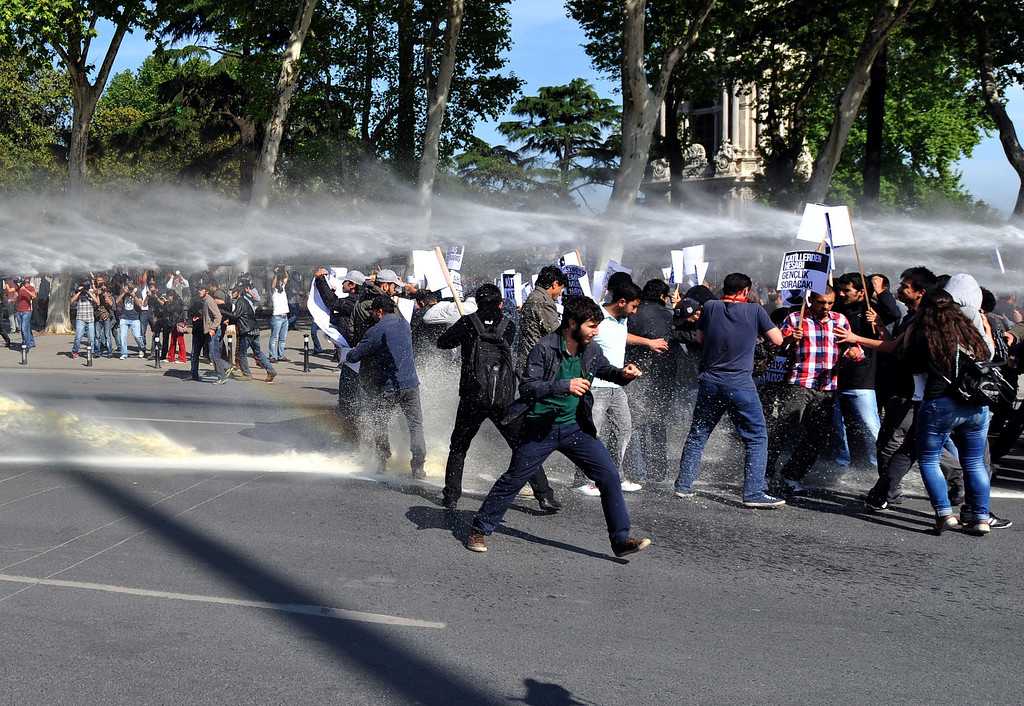 """. Riot police use water cannon against students in Istanbul on May 16, 2013 during a protest against government policies they say resulted in last weekend\'s deadly twin bombings. Some 500 students hurled stones at the police as they vowed that those behind the car bombs in Reyhanli, near the Syrian border, \""""will pay a price\"""" and demanded the resignation of Foreign Minister Ahmet Davutoglu. The attacks on Saturday, the deadliest in Turkey in years, killed at least 51 people and increased fears that the two-year conflict in Syria was dragging in neighbouring states. OZAN KOSE/AFP/Getty Images"""
