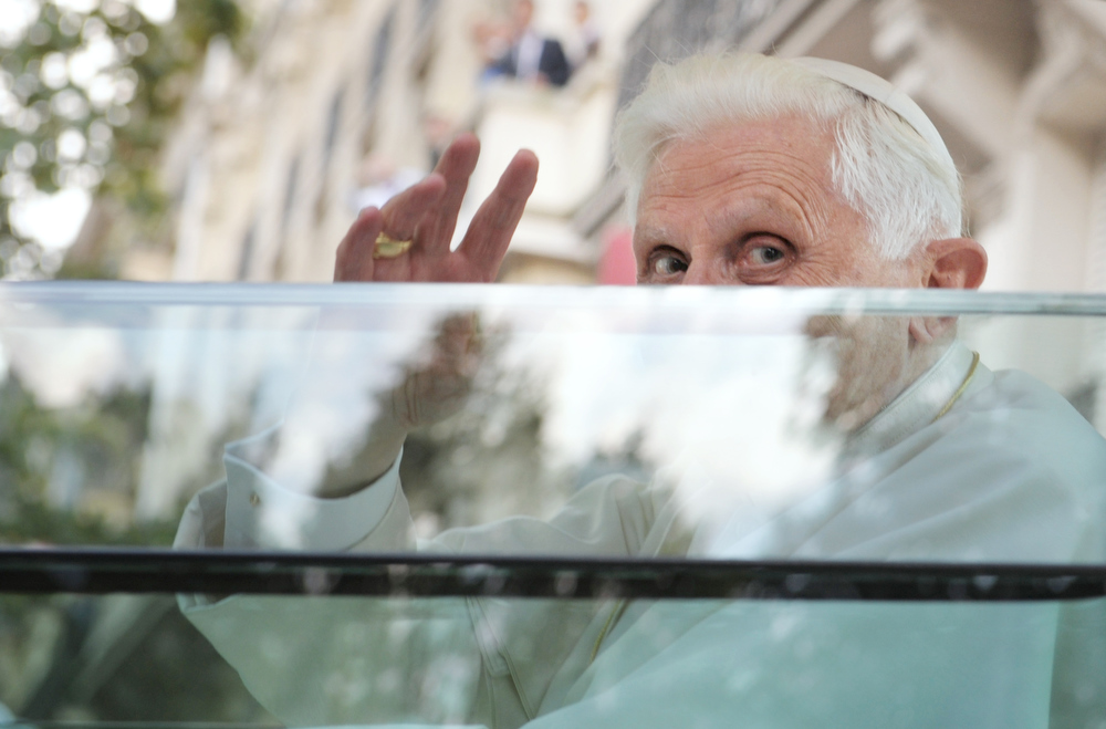 Description of . Pope Benedict XVI waves from the popemobile on his way for an evening prayer service at Notre Dame Cathedral on September 12, 2008 in Paris during his first visit to France. Pope Benedict XVI announced on February 11, 2013 he will resign on February 28, the first pontiff to step down in centuries. OLIVIER LABAN-MATTEI/AFP/Getty Images