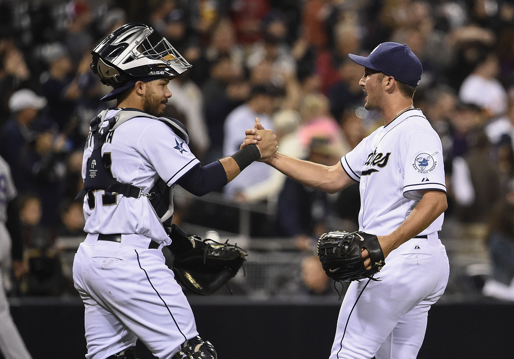 . SAN DIEGO, CA - APRIL 16:  Huston Street #16 of the San Diego Padres, right,  is congratulated by Rene Rivera #44 after getting the final out in the ninth inning of a baseball game against the Colorado Rockies at Petco Park April 16, 2014 in San Diego, California.  The Padres won 4-2. (Photo by Denis Poroy/Getty Images)