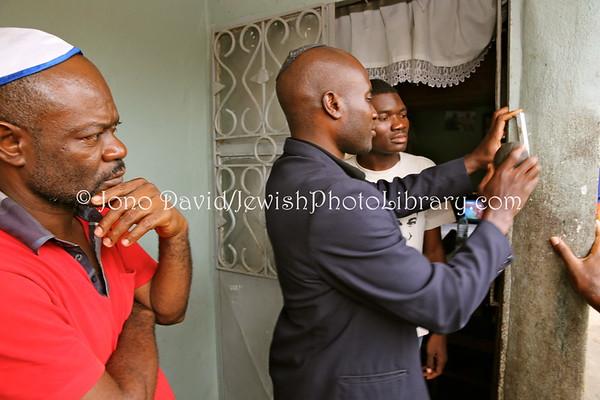 CAMEROON, Douala. Mezuzah, put up by spiritual leader Serge Etele (at Ambomo family home), Beth Yeshourun Jewish Community (2.2014)