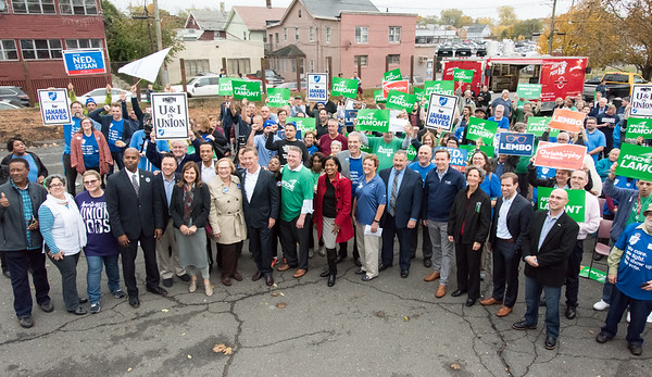 11/02/18 Wesley Bunnell | Staff The American Federation of Teachers held a get out the vote rally on Friday afternoon outside of a union headquarters in New Britain featuring hundreds of educators and workers from across CT. Candidates for office and union officials pose for a photo along with supporters.