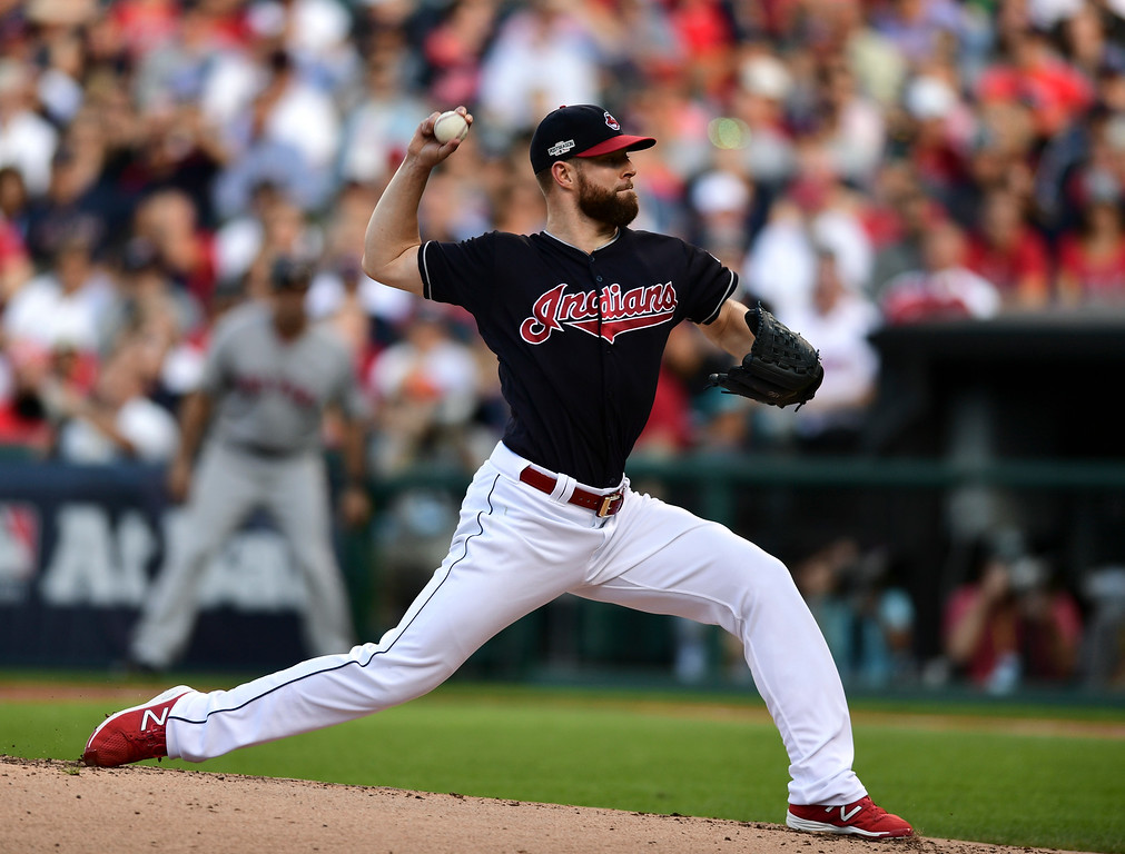 . Cleveland Indians pitcher Corey Kluber throws against the Boston Red Sox in the first inning during Game 2 of baseball\'s American League Division Series, Friday, Oct. 7, 2016, in Cleveland. (AP Photo/David Dermer)