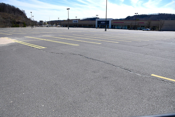 3/21/2020 Mike Orazzi | Staff Empty parking lots at the Connecticut Commons shopping center in Plainville on Saturday.