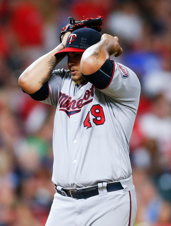. Minnesota Twins starting pitcher Adalberto Mejia reacts after hitting Cleveland Indians\' Yan Gomes with a pitch with the bases loaded during the fourth inning in a baseball game, Wednesday, Sept. 27, 2017, in Cleveland. The Indians won 4-2. (AP Photo/Ron Schwane)