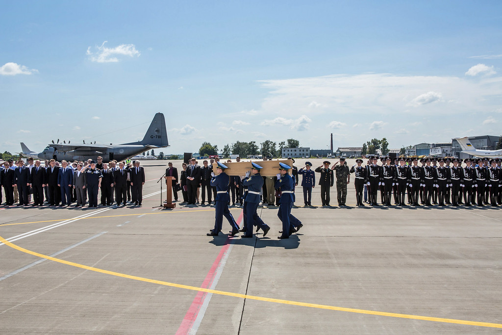 . A coffin containing the body of a victim of the crash of Malaysia Airlines flight MH17 is loaded onto a plane for transport to the Netherlands during a departure ceremony on July 23, 2014 in Kharkiv, Ukraine. Malaysia Airlines flight MH17 was travelling from Amsterdam to Kuala Lumpur when it crashed killing all 298 on board including 80 children. The aircraft was allegedly shot down by a missile and investigations continue over the perpetrators of the attack. (Photo by Brendan Hoffman/Getty Images)
