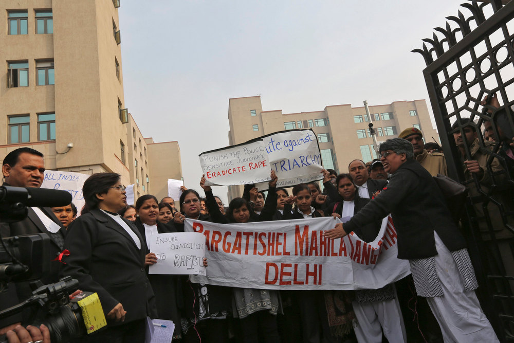 Description of . Lawyers shout slogans as they hold placards and a banner during a protest demanding the judicial system act faster against rape outside a district court in New Delhi January 3, 2013. The December 16 attack on the physiotherapy student and a male companion provoked furious protests close to the seat of government in New Delhi and has fuelled a nationwide debate about the prevalence of sexual crimes in India, where a rape is reported on average every 20 minutes. The woman died of her injuries in hospital in Singapore, where she had been taken for treatment, on Saturday. Five men and a teenager have been arrested in connection with the attack. The five men were due to be formally charged on Thursday. Murder carries the death penalty in India.  REUTERS/Adnan Abidi