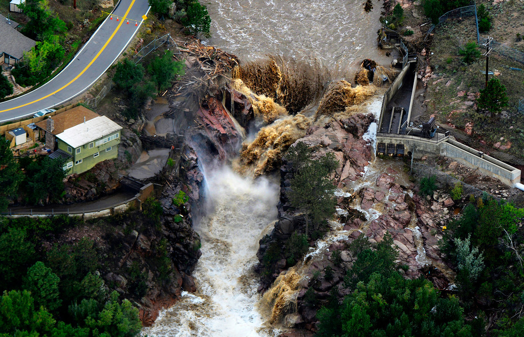 . The Big Thompson River rages through the washed out Loveland Water Storage Reservoir in Larimer County Colorado Saturday morning, September 14, 2013. (Photo By Andy Cross/The Denver Post)