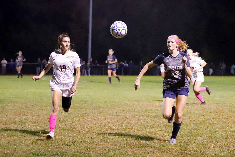 Butler sophomore Piper Geibel races North Allegheny's Riley Miara to a ball during Wednesday night's game at Butler. The Golden Tornado fell to the Tigers 3-0. Seb Foltz/Butler Eagle