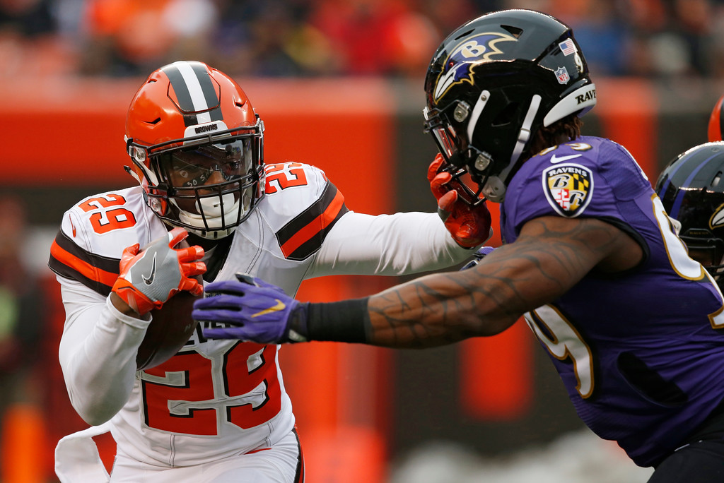 . Cleveland Browns running back Duke Johnson (29) tries to hold off Baltimore Ravens outside linebacker Matt Judon (99) during the first half of an NFL football game, Sunday, Dec. 17, 2017, in Cleveland. (AP Photo/Ron Schwane)