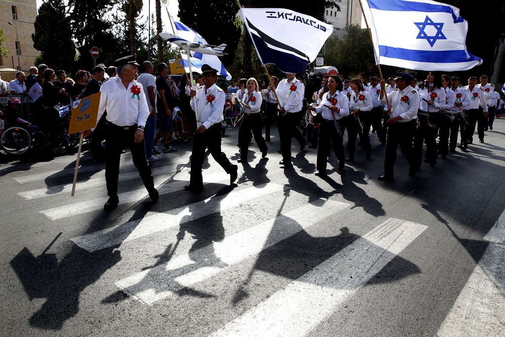 . Israelis march during a parade in celebration of the Jewish holiday of Sukkot (Tabernacles) and to express solidarity with Israel, in downtown Jerusalem, on September 24, 2013. Thousands of Israelis and Christian Evangelical supporters of the Jewish state marched today during their annual parade marking the Jewish holiday of Sukkot or the Feast of the Tabernacles. GALI TIBBON/AFP/Getty Images